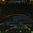 Tour Eiffel keeps away, night movement under Tour Eiffel. - Stock Photo