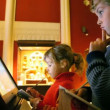 ストックビデオ: Girl and boy looks at interactive display in museum