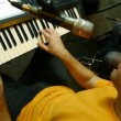 Keyboard player playing on synthesizer in recording studio — Stock Video #18191165