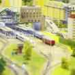 Train stand on rail on platform in modern toy city. image is washed away  — Stock Video