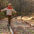 Stock Video: Boy walking on rail