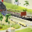 Toy train bring empty cargo wagon on rail to storage station in port near transport ship — Stock Video #18192165