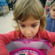 Stock Video: Little girl and boy playing logic game in mall
