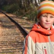 Portrait of boy standing on railroad tracks — Stock Video
