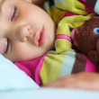 Stock Video: Little girl sleeping with toy bear in compartment of railway carriage