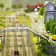 In small model city train arrives to wayside station and then picture is washed away — Vídeo de stock