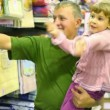 Family with little girl buying bedding in supermarket  — Stock Video