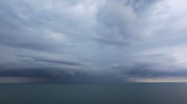 Lighting from dark storm clouds above waving Black Sea — Stock Video