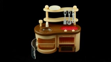 Assemblage of toy kitchen and table with dish. Time lapse. — Stock Video