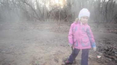 Little girl with stick standing near steaming sewer manhole — Stok video