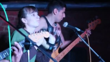 Musicians with guitars and tambourine live on stage — Stock Video