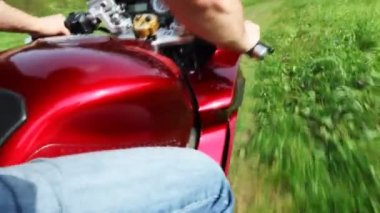 Motorcycle moving on road in park. Shooting from rider back — Vidéo