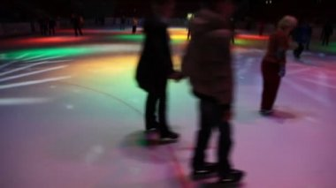 Skating in night skating rink with dynamic illumination — Stock Video