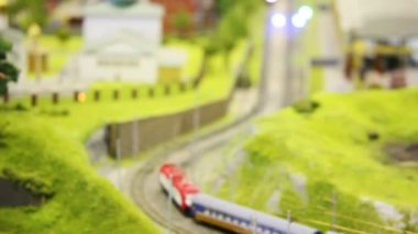 In small model city two train goes on meeting each other near church. Changing focus — Stock Video