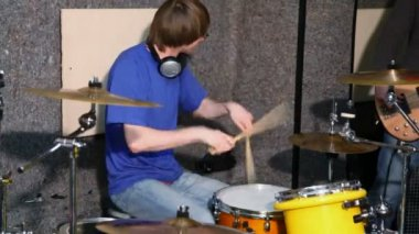 Drummer playing on drums in recording studio — Stock Video