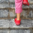 Feet of child walking up on ladder steps, camera follow child - Stock Photo