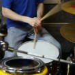 Unidentified drummer playing on dums in studio - Stock fotografie
