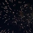 Night sky in fireworks flashes - Stock Photo