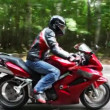 Red bike moves on asphalt road. Moving camera — Vídeo Stock