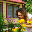 Yang woman smelling yellow Echinacea flowers — Stock Video