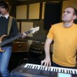 Guitarist and keyboard player playing in studio — Stock Video #19480709