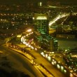 Brisk movement on a highway in a modern city in night. Time lapse. — Stock Video