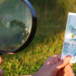Hands hold magnifying glass burning out thousand denomination. Lapse time - Stock Photo