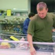 Man buying food stuff in supermarket — Stock Video