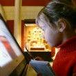 Stock Video: Little girl looks at interactive display in museum