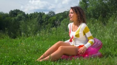 Young happy beautiful woman sitting on inflatable seat outdoors — Stock Video