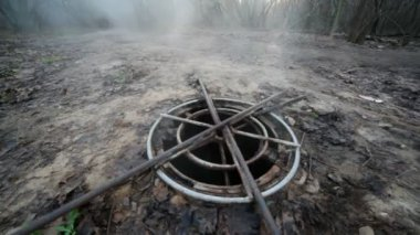 Steaming sewer manhole in forest — Stock video