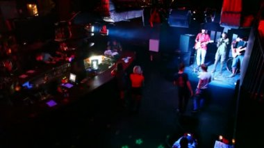 Musical group live on stage in club — Stock Video