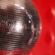 Stock Video: Rocking mirror disco ball in left side of frame