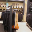 Hangers with clothes and shelves with headdresses — Stock Video