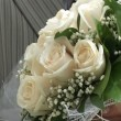 Stock Video: Bridegroom and bride holds wedding bouquet