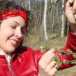 Happy young woman review branch with leaf buds in spring forest — Stock Video