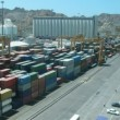 Brisk work in port: loading of cargoes, transportation of passengers. Time lapse. — Stock Video