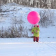 Girl plays with air-balloon in snowfield — Stock Video