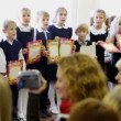 Children stand in row and sing song together at dedication meeting in first-graders of school number 1349 in Moscow — Stock Video #26756887