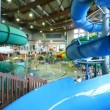 Stock Video: Stairs leading to water park with big pools, fountains and slides