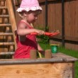 Little girl plays with sand mould in playdround near home — Stock Video
