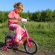 Girl treadling stopped bicycle, boy rides to her — Stock Video