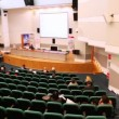 Presentation hall with rows of seats, listeners in them and speaker — Stock Video
