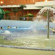 Stock Video: Bain pool with fountain in water park