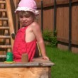 Little girl plays with sand mould in playdround near home — Stock Video #26757319