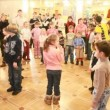 Stock Video: Adults hold competitions with participation of children in hallway of circus.