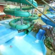 Stock Video: Bain pools and slip on inflatable rings in water park