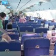 Plane salon: passengers sit, stewards approach to passengers. Time lapse. — Stock Video