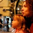 Stock Video: Mother talking with her daughter in space museum