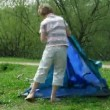Boy establishes tent on glade in summer day. Time lapse. — Stock Video #26758297